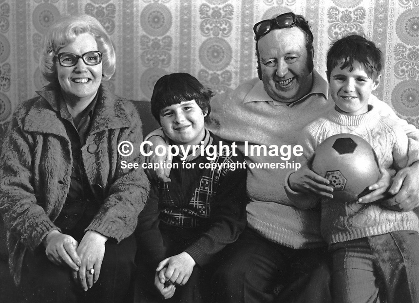SDLP politician Paddy Devlin with his wife, Theresa, and sons, Patrick &amp; Joseph,pictured in their home, Andersonstown, Belfast, N Ireland. 19750523WP01<br /> <br /> Copyright Image from Victor Patterson, 54 Dorchester Park, <br /> Belfast, UK, BT9 6RJ<br /> <br /> t1: +44 28 9066 1296 (from Rep of Ireland 048 9066 1296)<br /> t2: +44 28 9002 2446 (from Rep of Ireland 048 9002 2446)<br /> m: +44 7802 353836<br /> <br /> e1: victorpatterson@me.com<br /> e2: victorpatterson@gmail.com<br /> www.victorpatterson.com<br /> <br /> Please see my Terms and Conditions of Use at www.victorpatterson.com. It is IMPORTANT that you familiarise yourself with them.<br /> <br /> Images used on the Internet must be visibly watermarked i.e. &copy; Victor Patterson<br /> within the body of the image and copyright metadata must not be deleted. Images <br /> used on the Internet have a size restriction of 4kbs and will be chargeable at current<br />  NUJ rates unless agreed otherwise.<br /> <br /> This image is only available for the use of the download recipient i.e. television station, newspaper, magazine, book publisher, etc, and must not be passed on to any third <br /> party. It is also downloaded on condition that each and every usage is notified within 7 days to victorpatterson@me.com<br /> <br /> The right of Victor Patterson to be identified as the author is asserted in accordance with The Copyright Designs And Patents Act (1988).