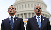United States President Barack Obama and U.S. Attorney General Eric Holder attend the 32nd Annual National Peace Officers' Memorial Service at the West Front Lawn of the U.S. Capitol May 15, 2013 in Washington, DC. Obama attended the annual event to honor law enforcement who were killed in the line of duty in the previous year..Credit: Olivier Douliery / Pool via CNP