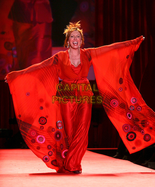 CHERYL BENTYNE.The Heart Truth Red Dress Collection Fashion Show .The Olympus Fashion Week,.New York, New York, USA,.3rd February 2006..full length runway catwalk celebrity modelling .Ref: IW .www.capitalpictures.com.sales@capitalpictures.com.©Capital Pictures