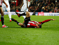 Andreas Bjelland of Brentford takes a knock to the head during the Sky Bet Championship match between Brentford and Leeds United at Griffin Park, London, England on 4 November 2017. Photo by Carlton Myrie.