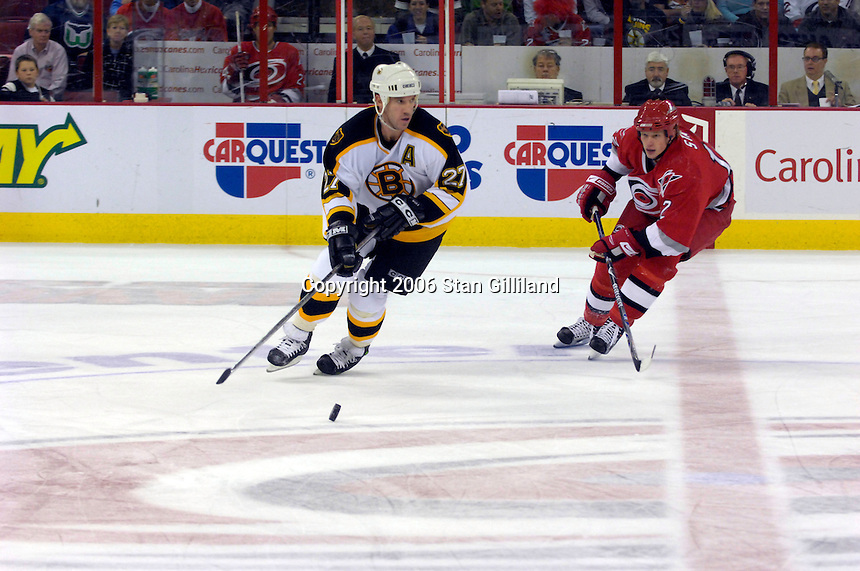 The Boston Bruins' Glen Murray (27) tries to carry the puck across the center line defended by the Carolina Hurricanes' Eric Staal (12) during an NHL hockey game Saturday, Dec. 2, 2006 in Raleigh, N.C. Carolina won 5-2.<br />