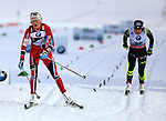 04/01/2014, Val Di Fiemme - 2014 Cross Country Ski World Cup Tour de ski <br /> Therese Johaug (NOR), Coraline Hugue (FRA) in action during the Women 5 km Classic Individual in Val Di Fiemme, Italy on 04/01/2014.<br /> <br /> &copy; Pierre Teyssot