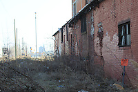 wrong side of the tracks desolate abandoned warehouse in detroit