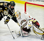 12 November 2010: Boston College Eagle goaltender John Muse, a Senior from East Falmouth, MA, makes a save on UVM forward Matt White, a Freshman from McMurray, PA, during game action against the University of Vermont Catamounts at Gutterson Fieldhouse in Burlington, Vermont. The Eagles edged out the Cats 3-2 in the first game of their weekend series. Mandatory Credit: Ed Wolfstein Photo
