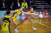 Paige Hadley takes a pass under pressure from Joline Henry during the ANZ Netball Championship match between the Central Pulse and NSW Swifts at TSB Bank Arena, Wellington, New Zealand on Saturday, 25 April 2015. Photo: Dave Lintott / lintottphoto.co.nz