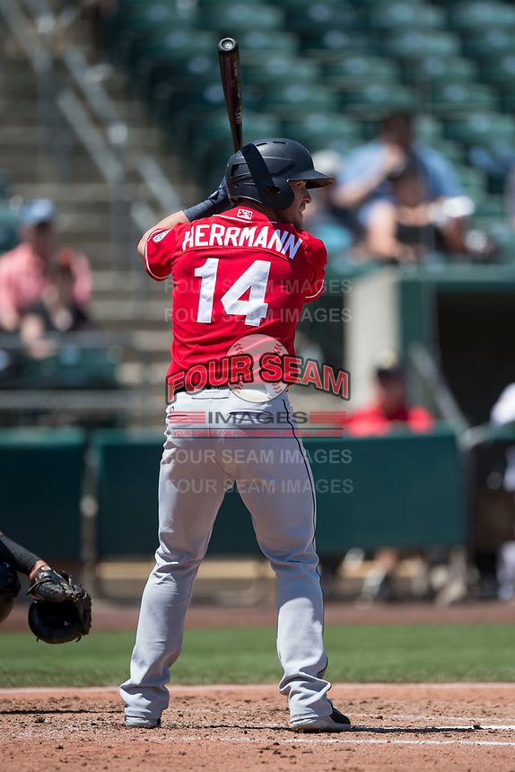 Tacoma Rainiers catcher Chris Herrmann (14) at bat during a Pacific Coast League game against the Sacramento RiverCats at Raley Field on May 15, 2018 in Sacramento, California. Tacoma defeated Sacramento 8-5. (Zachary Lucy/Four Seam Images)