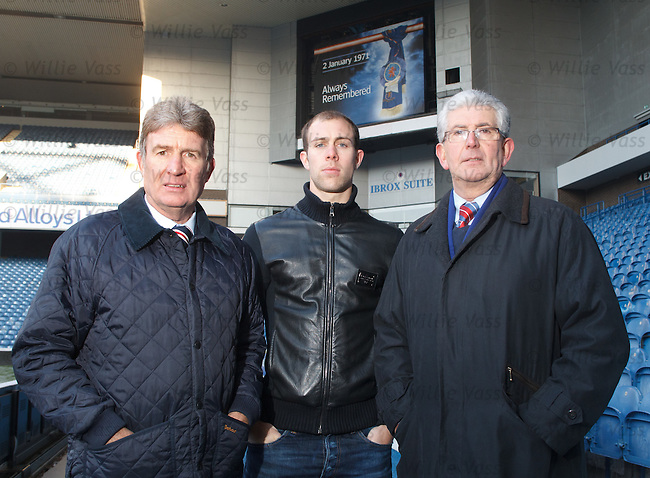 Sandy Jardine, Steven Whittaker and Ian Loch who attended the match on 2nd January 1971 at Ibrox Stadium beneath a banner memorial to the 66 dead.