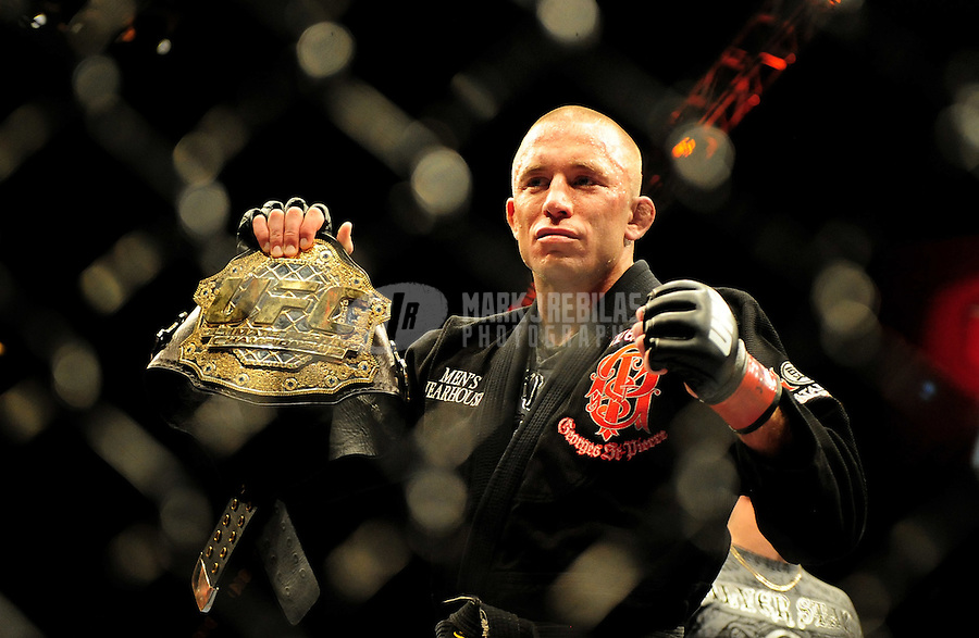 Jan. 31, 2009; Las Vegas, NV, USA; UFC fighter Georges St-Pierre celebrates with the champions belt after defeating B.J. Penn (not pictured) during the welterweight championship in UFC 94 at the MGM Grand Hotel and Casino. St-Pierre defeated Penn with a fourth round TKO. Mandatory Credit: Mark J. Rebilas-