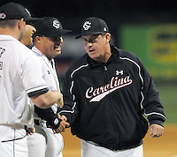 Head coach Ray Tanner (1) of the South Carolina Gamecocks shakes hands with his coaches as he is introduced before a game against the Clemson Tigers on Tuesday, March 8, 2011, at Fluor Field in Greenville, S.C. USC won 5-4.  Photo by Tom Priddy / Four Seam Images