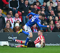 Lincoln City's Michael O'Connor battles with Macclesfield Town's Michael Rose<br /> <br /> Photographer Andrew Vaughan/CameraSport<br /> <br /> The EFL Sky Bet League Two - Lincoln City v Macclesfield Town - Saturday 30th March 2019 - Sincil Bank - Lincoln<br /> <br /> World Copyright © 2019 CameraSport. All rights reserved. 43 Linden Ave. Countesthorpe. Leicester. England. LE8 5PG - Tel: +44 (0) 116 277 4147 - admin@camerasport.com - www.camerasport.com