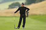 Spanish golfer Miguel Angel Jimenez watches as his second shot to the par 5 18th hole rolls into the water.<br /> <br /> 29.08.13<br /> <br /> &copy;Steve Pope-Sportingwales