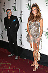 """John Demsey and Kelly Killoren Bensimon  attending Bette Midler's New York Restoration Project's Annual """"Hulaween in the Big Easy"""" at  the Waldorf Astoria on October 31, 2013  in New York City."""