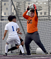 Westside Eagle Observer/MIKE ECKELS<br /> <br /> Bulldog goalie Lauro Molina (00) catches a Panther shooting attempt preventing a goal during the first half of the Siloam Springs-Decatur non-conference soccer match at Panther Stadium in Siloam Springs March 12.