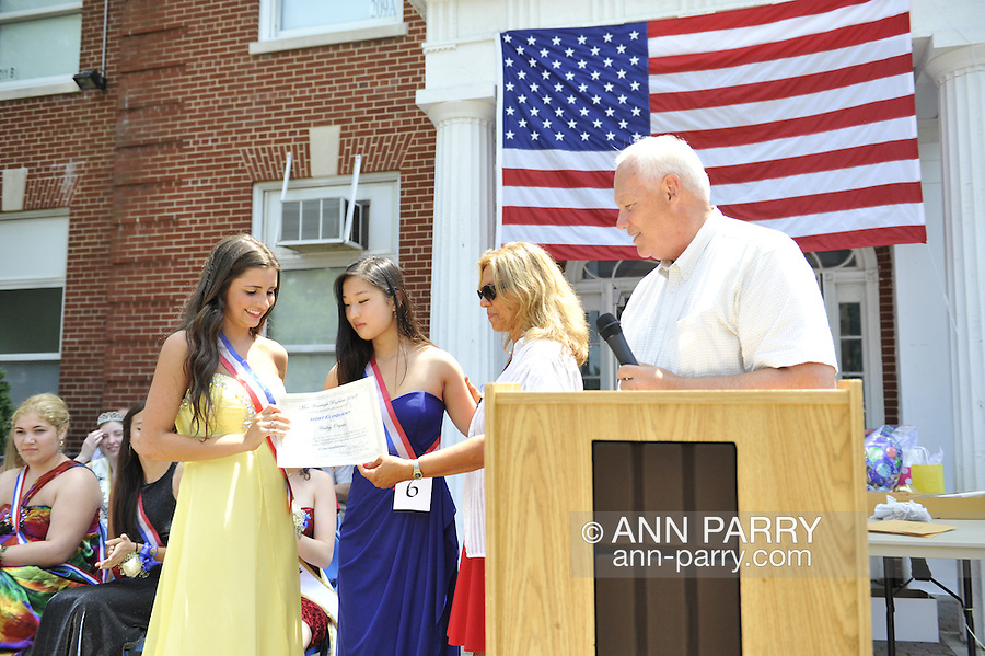 Miss Wantagh Pageant ceremony, a long-time Independence Day tradition on Long Island, is Wednesday, July 4, 2012, at Wantagh School, New York, USA. The Miss Eloquent Winners were Hailey Orgass, Miss Wantagh 2012, and Belinda Lia (center in blue gown). Since 1956, the Miss Wantagh Pageant, which is not a beauty pageant, has crowned a high school student based mainly on academic excellence and community service.