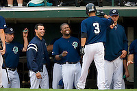 (L-R) Brian Myrow #33, Carlos Torres #2 and Wilson Betemit #24  of the Charlotte Knights are all smiles as Eider Torres #3 returns after hitting his first home run of the season at Knights Stadium June 23, 2009 in Fort Mill, South Carolina. (Photo by Brian Westerholt / Four Seam Images)