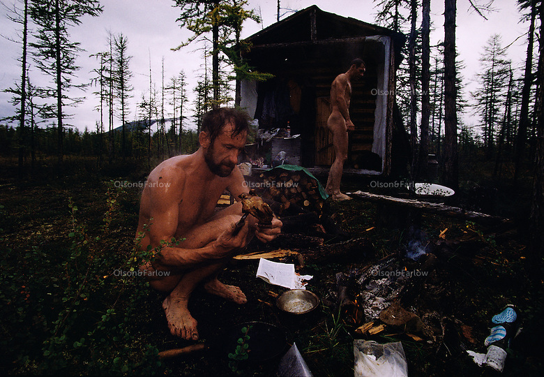Russian Geographic Society scientists rough it out on a research trip in the Siberian arctic. Clothes are an option at lunch.