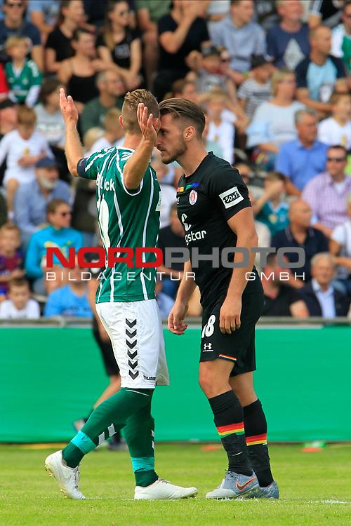 11.08.2019, Stadion Lohmühle, Luebeck, GER, DFB-Pokal, 1. Runde VFB Lübeck vs 1.FC St. Pauli<br /> <br /> DFB REGULATIONS PROHIBIT ANY USE OF PHOTOGRAPHS AS IMAGE SEQUENCES AND/OR QUASI-VIDEO.<br /> <br /> im Bild / picture shows<br /> Daniel Halke (VfB Luebeck) und Dimitrios Diamantakos (FC St. Pauli) geraten aneinander.<br /> <br /> Foto © nordphoto / Tauchnitz
