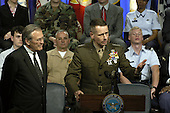 United States Secretary of Defense Donald H. Rumsfeld, left,  listens as Vice Chairman of the Joint Chiefs of Staff General Peter Pace, United States Marine Corps, responds to a question during a Pentagon Town Hall meeting on May 11, 2004.  Rumsfeld and Pace made opening remarks and then took questions from the audience of military and Department of Defense (DoD) civilians.                     <br /> Mandatory Credit: Helene Stikkel / DoD via CNP