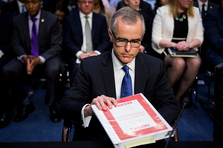 "UNITED STATES - MAY 11: Acting FBI Director Andrew McCabe prepares to testify during the Senate (Select) Intelligence Committee hearing on ""World Wide Threats"" on Thursday, May 11, 2017. (Photo By Bill Clark/CQ Roll Call)"