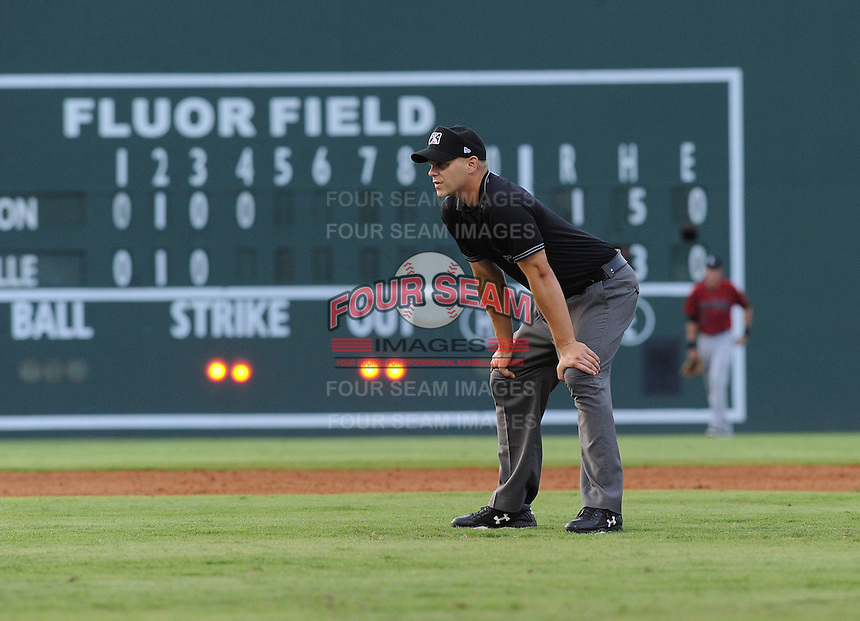 Umpire Dane Ratajski works a game between the Lexington Legends and the Greenville Drive on July 19, 2012, at Fluor Field at the West End in Greenville, South Carolina. (Tom Priddy/Four Seam Images)