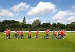 Nederland, Utrecht, 30 juni 2012.Eerste training van FC Utrecht .Spelers van FC Utrecht lopen een rondje op het trainingsveld