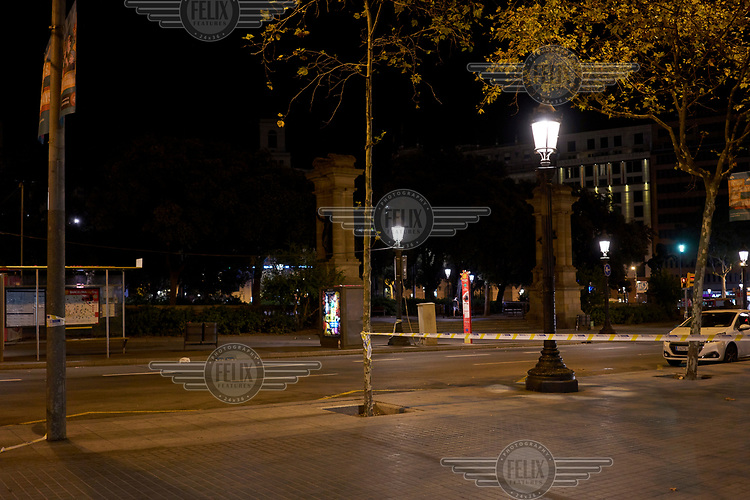 "A view of La Rambla ( Las Ramblas ), cordoned off by police after a van driven by Younes Abouyaaqoub drove into crowds of pedestrians, killing 14 and wounding dozens on 17 August. He fled the scene but was tracked down by police and shot dead on 21 August near Barcelona. The Spanish prime minister called the event ""a jihadist attack"" and the Islamic State (ISIS) claimed responsibility."