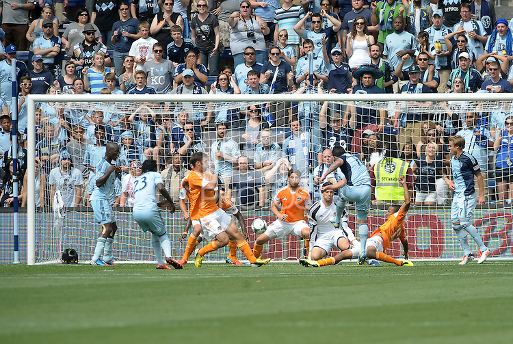 Claudio Bieler (16) forward Sporting KC shoots on the Houston goal despite the out stretched leg of Ricardo Clark..Sporting Kansas City and Houston Dynamo played to a 1-1 tie at Sporting Park, Kansas City, Kansas.