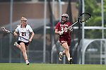 CHAPEL HILL, NC - MAY 12: Elon's Rachel Ramirez (30) is chased by Virginia's Besser Dyson (21). The Elon University Phoenix played the University of Virginia Cavaliers on May 12, 2017, at Fetzer Field in Chapel Hill, NC in an NCAA Women's Lacrosse Tournament First Round match. Virginia won the game 11-9.