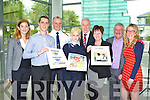 Minister Jimmy Deenihan with the winners and judges of the Cultural diversity and Integration poster campaign competition at the Government buildings in Killarney on Monday l-r: Deirdre Walsh Radio Kerry, Declan Sugrue Caherciveen, Chief Superintendent Pat Sullivan, Teegan Meehan Ballybunion (overall winner), Minister Jimmy Deenihan, Maryanne Keane Lixnaw, Sean Lyons Chairman of Listowel Writers week and Sinead Kelleher Kerry's Eye