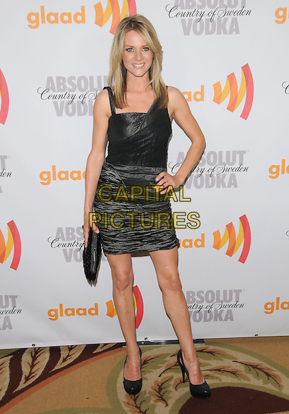 JESSALYN GILSIG .at the 21st Annual GLAAD Media Awards held at The Hyatt Regency Century Plaza in Century City, California  USA, April 17th 2010.       .full length black sleeveless ruched shiny dress hand on hip shoes clutch bag .CAP/RKE/DVS.©DVS/RockinExposures/Capital Pictures.