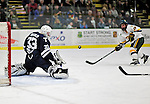 30 November 2009: Yale University Bulldog goaltender Jeff Malcolm, a Freshman from Lethbridge, Alberta, makes a third period save on University of Vermont Catamount forward Jay Anctil, a Senior from Wolfeboro, NH, at Gutterson Fieldhouse in Burlington, Vermont. Malcolm stopped 26 of 27 shots in his second collegiate start as the Catamounts shut out the Bulldogs 1-0 in a rematch of last season's first round of the NCAA post-season playoff Tournament. Mandatory Credit: Ed Wolfstein Photo