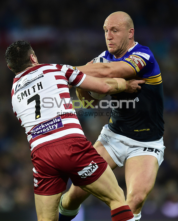 Picture by Alex Broadway/SWpix.com - 10/10/2015 - Rugby League - First Utility Super League Grand Final - Leeds Rhinos v Wigan Warriors - Old Trafford, Manchester, England - Carl Ablett of Leeds Rhinos is tackled by Matthew Smith of Wigan Warriors.