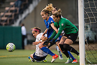 Seattle, Washington -  Sunday, September 11 2016: Seattle Reign FC midfielder Beverly Yanez (17), Washington Spirit defender Whitney Church (5) and Washington Spirit goalkeeper Kelsey Wys (18) collide for the ball during a regular season National Women's Soccer League (NWSL) match between the Seattle Reign FC and the Washington Spirit at Memorial Stadium. Seattle won 2-0.