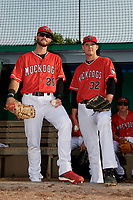 Batavia Muckdogs first baseman Evan Edwards (26) and starting pitcher Remey Reed (32) get ready to take the field before a NY-Penn League game against the Auburn Doubledays on June 14, 2019 at Dwyer Stadium in Batavia, New York.  Batavia defeated 2-0.  (Mike Janes/Four Seam Images)