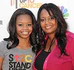 LOS ANGELES, CA - SEPTEMBER 07: Gabrielle Douglas and Natalie Hawkins arrive at Stand Up To Cancer at The Shrine Auditorium on September 7, 2012 in Los Angeles, California.