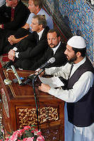 (Oslo July 26, 2011)  Crown Price Haakon looks at imam Najeeb Naz speaking at the mosque World Islamic Mission in Oslo...A large vehicle bomb was detonated near the offices of Norwegian Prime Minister Jens Stoltenberg on 22 July 2011. .Another terrorist attack took place shortly afterwards, where a man killed 68 people, mainly children and youths attending a political camp at Utøya island. ..Anders Behring Breivik was arrested on the island and has admitted to carrying out both attacks..(photo:Fredrik Naumann/Felix Features)