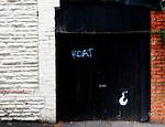 Derelict  double doors with graffiti