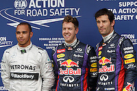 The 3rd, 1st and 2nd place qualifiers, Lewis Hamilton (GBR) from the Mercedes AMG Petronas F1 Team, and Sebastian Vettel (DEU), and Mark Webber (AUS) both from the Infiniti Red Bull Racing team pose for photographs after the final qualifying session on day four of the 2013 Formula One Rolex Australian Grand Prix at the Albert Park Circuit in Melbourne, Australia.
