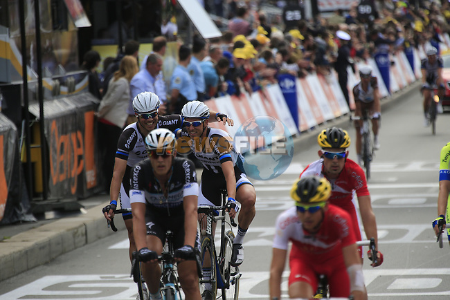 Marcel Kittel's (GER) Team Giant-Shimano team mates cross the finish line job well done after Kittel wins Stage 4 of the 2014 Tour de France running 163.5km from Le Touquet to Lille. 8th July 2014.<br /> Picture: Eoin Clarke www.newsfile.ie