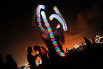 """Juggler at """"Mid Burn"""", the Israeli """"Burning Man Festival"""" held at """"Habonim"""" beach north of Israel October 4-6, 2012."""