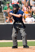 Home plate umpire Joseph Born calls a strike in a South Atlantic League game between the Delmarva Shorebirds and the Kannapolis Intimidators at Fieldcrest Cannon Stadium June 2, 2009 in Kannapolis, North Carolina. (Photo by Brian Westerholt / Four Seam Images)