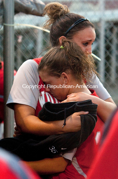 STRATFORD, CT 07 JUNE, 2010-060710JS08- Wolcott senior Coree Charette (35) gives a hug to fellow senior and teammate Keyleigh Kirkendall (10) following their 7-1 loss to St. Joseph in the Class M semifinals Monday at DeLucia Field in Stratford. <br /> Jim Shannon Republican-American