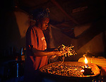 Working by candlelight, Imaculador Dupres sorts beans in her home in Despagne, a rural village in southern Haiti where the Lutheran World Federation has been working with residents to improve their quality of life.
