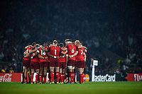 The England team huddle together prior to the match. Rugby World Cup Pool A match between England and Fiji on September 18, 2015 at Twickenham Stadium in London, England. Photo by: Patrick Khachfe / Onside Images