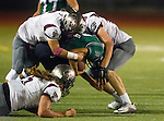 Torrance, CA 10/09/15 - Gabe Zuniga (South #13), Tyler Maseuli (Torrance #5) and unidentified Torrance player(s) in action during the Torrance vs South High varsity football game.  South defeated Torrance 24-21.