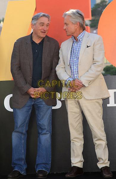Robert De Niro, Michael Douglas<br /> &quot;Last Vegas&quot; cast received the key to Vegas at the Bellagio Fountain, Las Vegas, NV, USA, 18th October 2013.<br /> full length beige suit brown jacket jeans <br /> CAP/ADM/MJT<br /> &copy; MJT/AdMedia/Capital Pictures