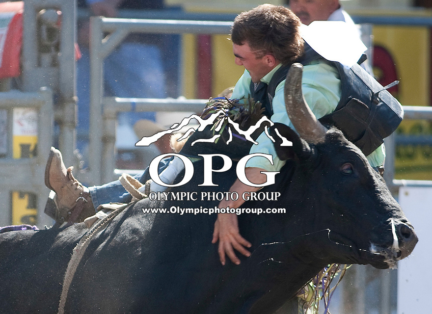 28 Aug 2011: Sunshine Schwartz hangs on for dear life after being rewarded a re-ride. Schwartz was not able to score during the first round of the Seminole Hard Rock Extreme Bulls competition at the Kitsap County Stampede in Bremerton, Washington.