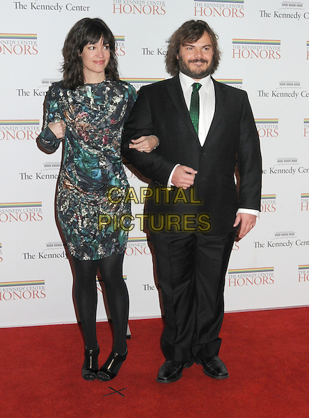 TANYA HAYDEN & JACK BLACK .Gala Dinner honoring the 32nd Kennedy Center Honors held at the State Department, Washington DC, USA, .5th December 2009..full length black suit green tie dress tights married couple husband wife print .CAP/ADM/LF.©Laura Farr/Admedia/Capital Pictures