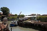 Dredging and strengthening of canal bank on Murano, Venice lagoon, Italy. May 2007.