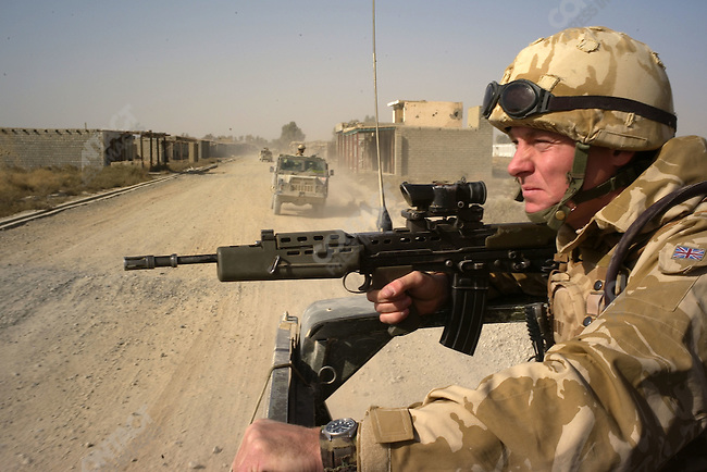 Out on patrol with the Gurkhas of B Co. of the Royal Gurkha Rifles (1RGR) in Garmsir. This British soldier is under the command of the Household Cavalry. Helmand, Afghanistan, November 2007.